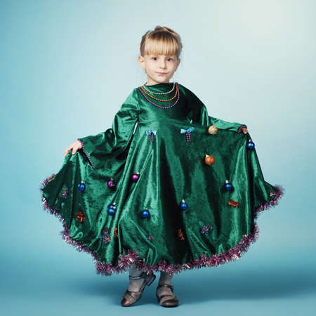 cute little girl with christmas tree dress photo