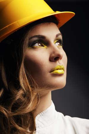 Beautiful girl with yellow helmet portrait photo