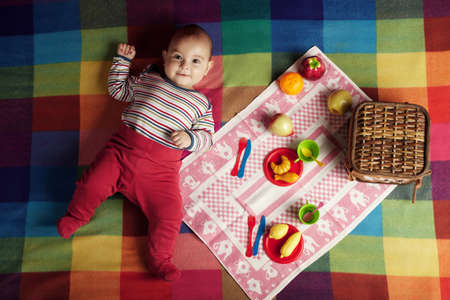 cute little baby on picnic portrait photo