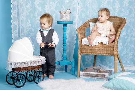 cute children with baby carriage. Happy family concept photo