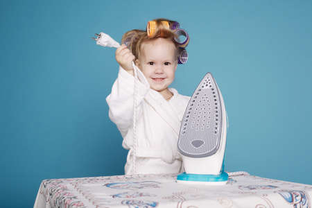 little funny housewife with iron photo