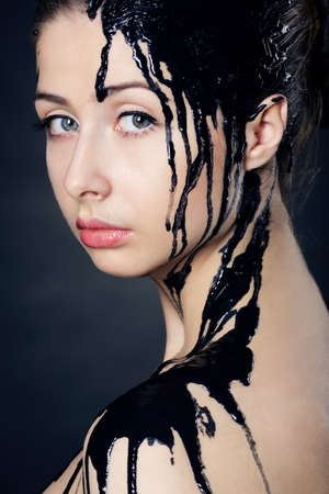 beautiful girl with flowing down the face paint photo