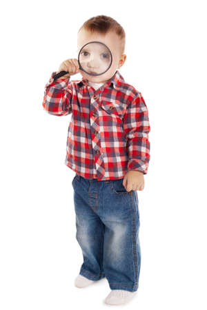 little boy with magnifier on white photo