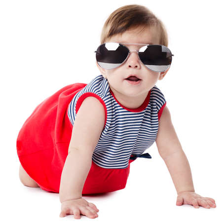 cute baby with sunglasses isolated on white background photo