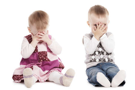 hands covering eyes: cute children playing hide and seek