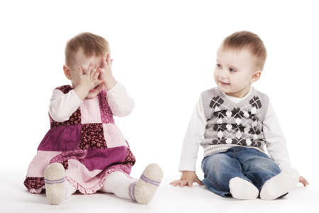 cute children playing hide and seek photo