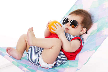 cute baby lying on lounger isolated on white Stock Photo