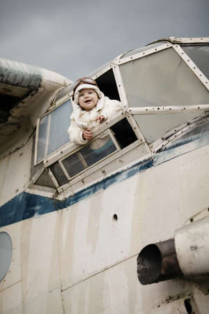 sweet little baby dreaming of being pilot Stock Photo - 26860796