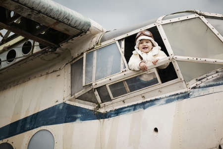 sweet little baby dreaming of being pilot Stock Photo - 26860799