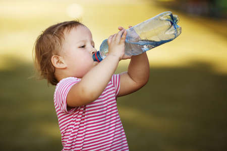 little girl with bottle of mineral water
