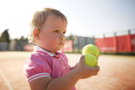 little funny girl plays tennis photo