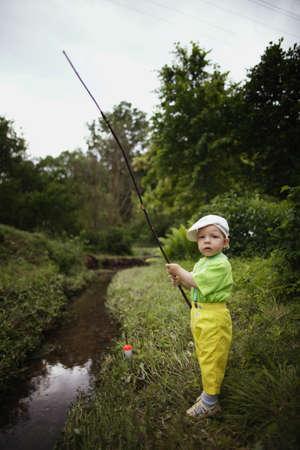 photo of little cute boy fishing photo