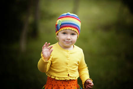 greets: little funny girl greets hands up Stock Photo