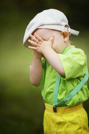 hide and seek: little funny boy plays hide and seek