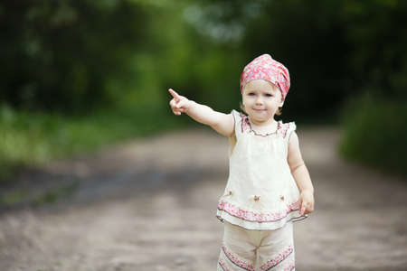 little beautiful girl points up photo