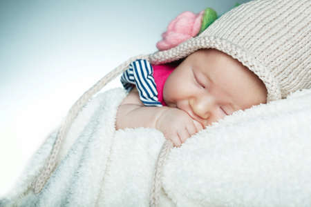 cute little funny sleepeng baby with hat photo