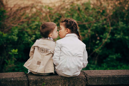 Small and pretty child fell lovely and happy it is  first kiss Stock Photo