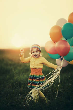 little girl with colorful balloons photo