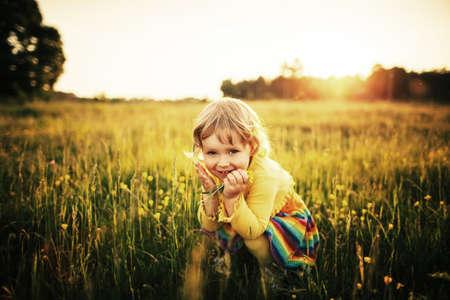 cute little girl on meadow 写真素材