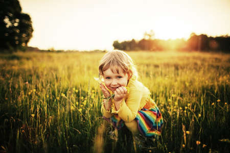 cute little girl on meadow Archivio Fotografico