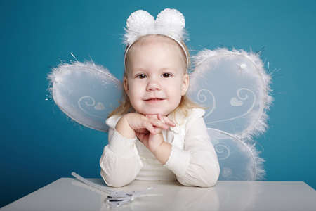 Cute little girl with butterfly costume photo