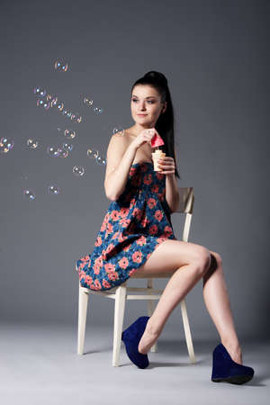 blowing bubbles: beautiful brunette girl with bubbles Stock Photo
