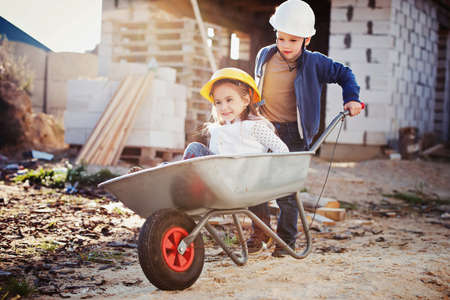 boy and girl playing on construction site Stockfoto