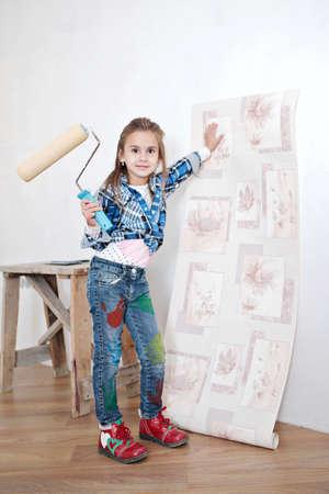 Cute little girl hanging wallpaper photo