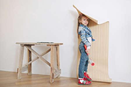 Cute little girl hanging wallpaper