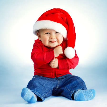 blue christmas background: little boy with santa costume