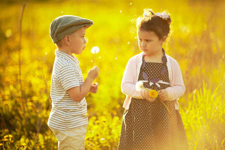 play date: boy and girl in summer field Stock Photo