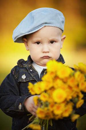 cute little boy with dandelions photo