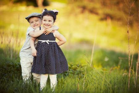 happy boy and girl hug
