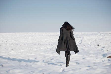 hair back: beautiful girl alone in winter field Stock Photo