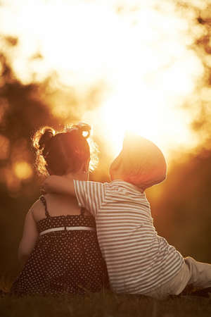 lovely boy and girl on sunset photo