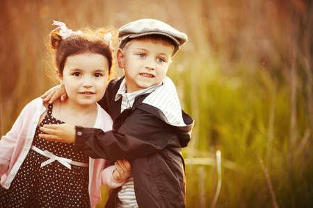 flowers boy: happy little boy and girl hug