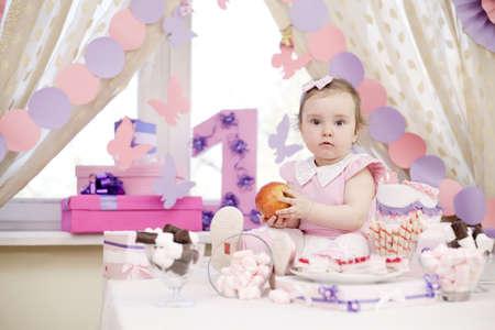 first birthday: baby girl celebrating first birthday