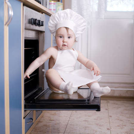 baby chef cooks in the oven food photo