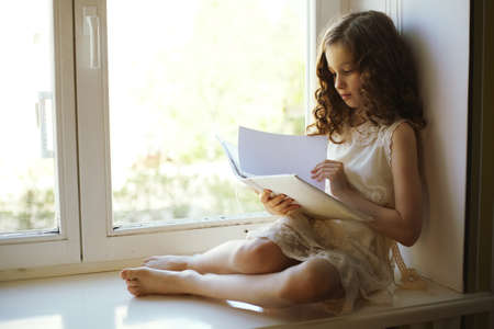 beautiful preteen girl: girl reading a book