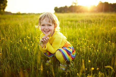 little happy girl on the meadow Фото со стока