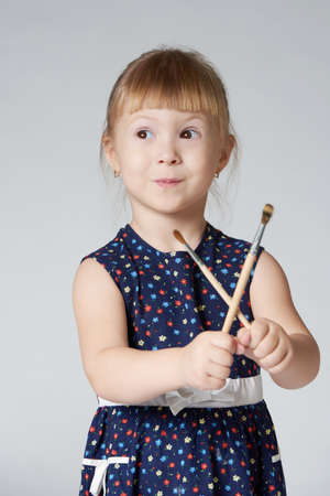 little cute girl painting photo