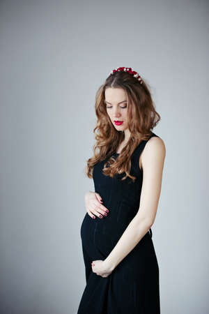beautiful pregnant woman at home portrait photo