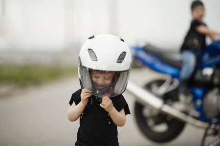 cute little bikers on road with motorcycle Banque d'images