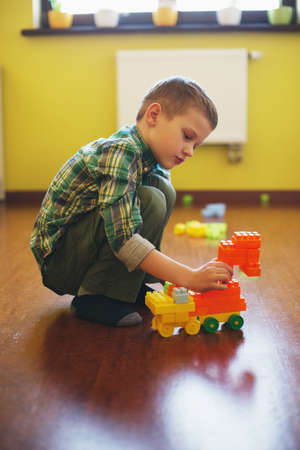 ��beautiful boy�: Happy beautiful boy plays with blocks at home Stock Photo
