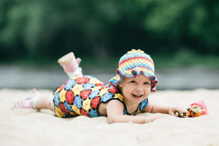 colorful dress: Cute little girl with bright colorful dress