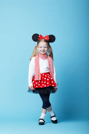 little beautiful girl with mouse mask on blue