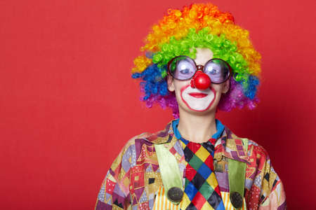 funny glasses: funny clown with glasses on red backround