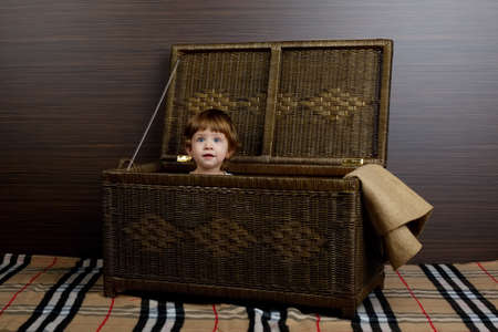 conform: photo of beautiful little girl sitting in suitcase