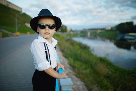 photo of little gentleman with sunglasses outdoors portrait Archivio Fotografico