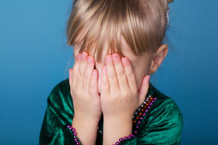 seek: Little funy girl plays hide and seek Stock Photo